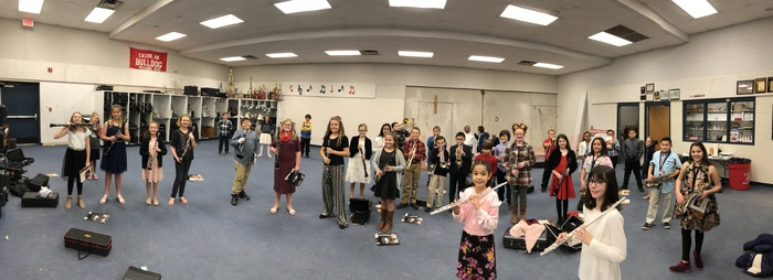 5th grade students warming up before their performance.