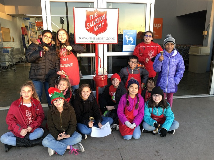 5th Grade Students participate in ringing the bell for Salvation Army.